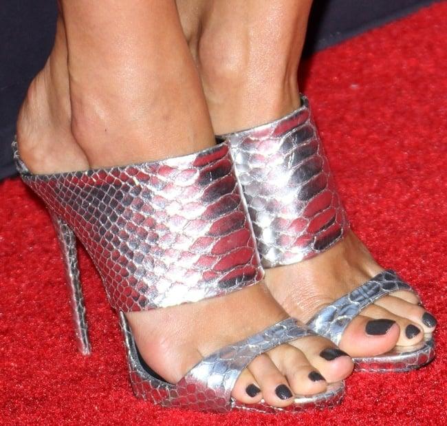 A closer look at Jessica's metallic snake-print sandals