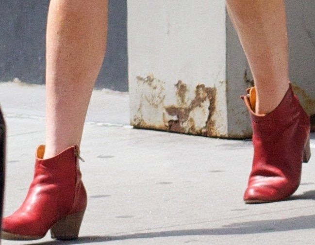 Lindsay Lohan wearing poppy Dicker red ankle boots