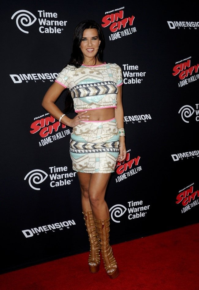 Natalie Burn at the premiere in matching micro-mini separates paired with chunky knee-high gladiator sandals