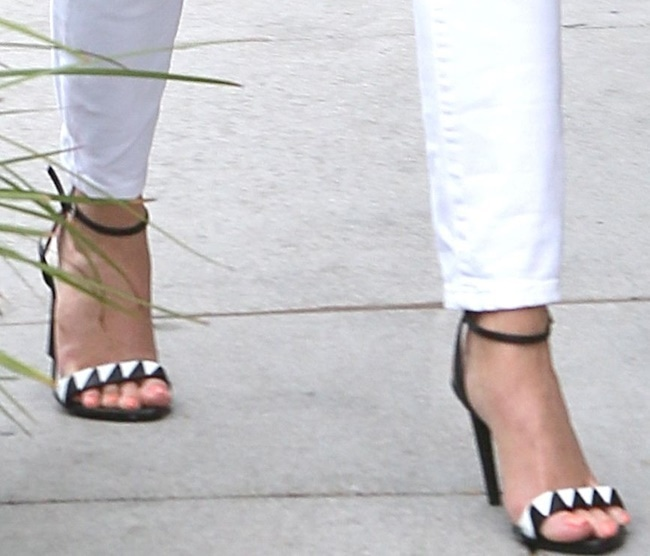 Reese Witherspoon's feet in black-and-white ankle-strap sandals