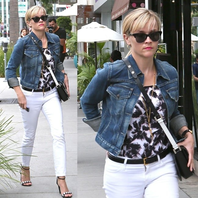 Reese Witherspoon wearing a black-and-white outfit jazzed up with a touch of denim