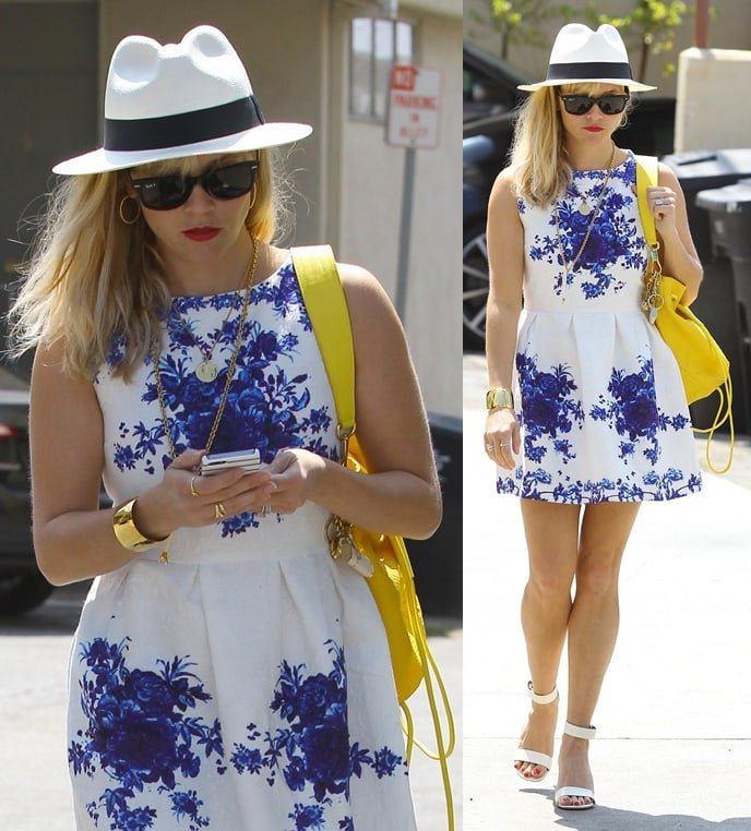 Reese Witherspoon stepping out in a cute blue-and-white floral dress