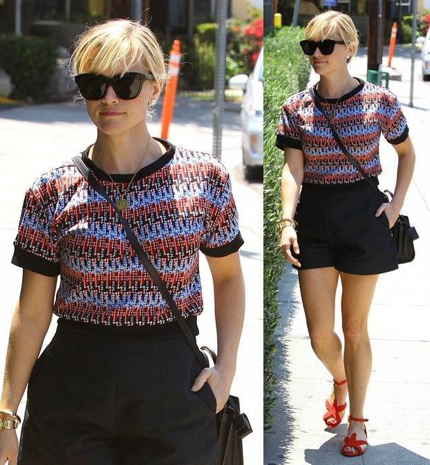 Reese Witherspoon in red, black, and blue as she checks out a new home