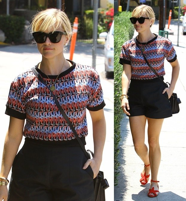 Reese Witherspoon inred, black, and blue as she checks out a new home