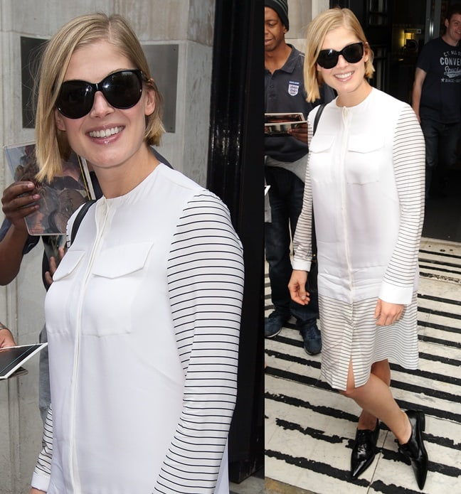 A pregnant Rosamund Pike wore a white long-sleeved shirtdress with black pointy lace-ups and black peepers