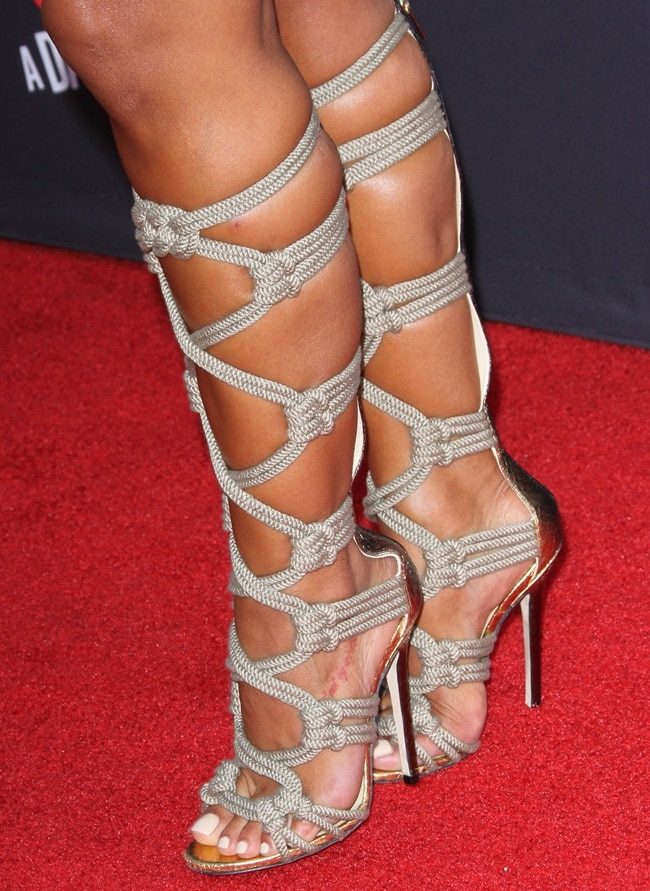 Rocsi Diaz showing off her feet in knee-high rope-strap sandals