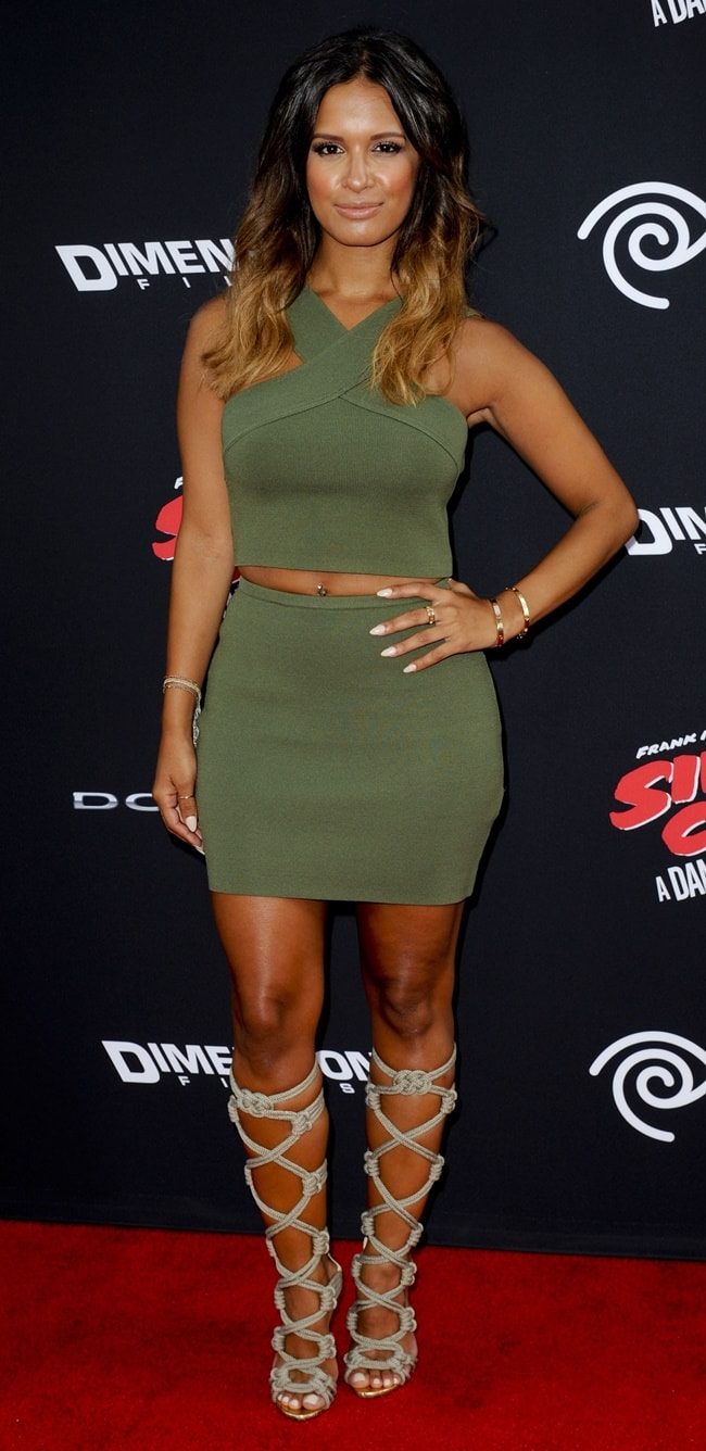 Rocsi Diaz flaunting her figure in a similar two-piece skirt ensemble paired with knee-high rope-strap sandals