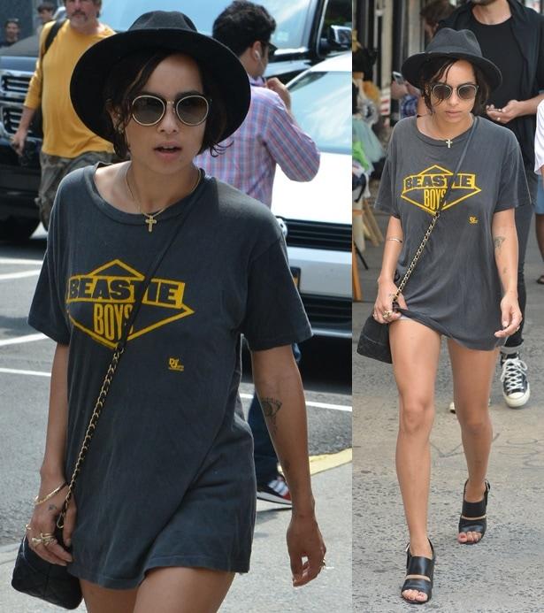 Zoe Kravitz wearing a long t-shirt over her short denim cutoffs