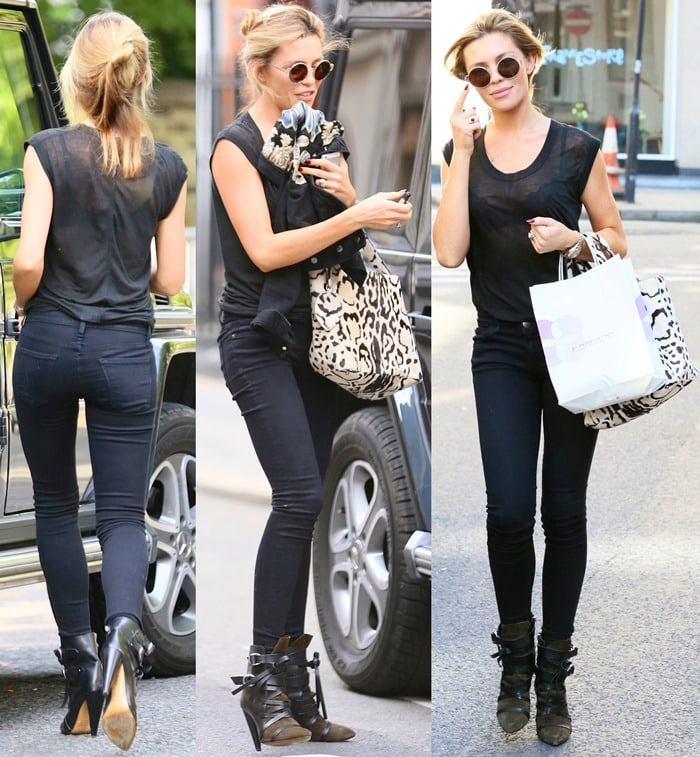 Abbey Clancy ina sheer black tee and black skinny jeans