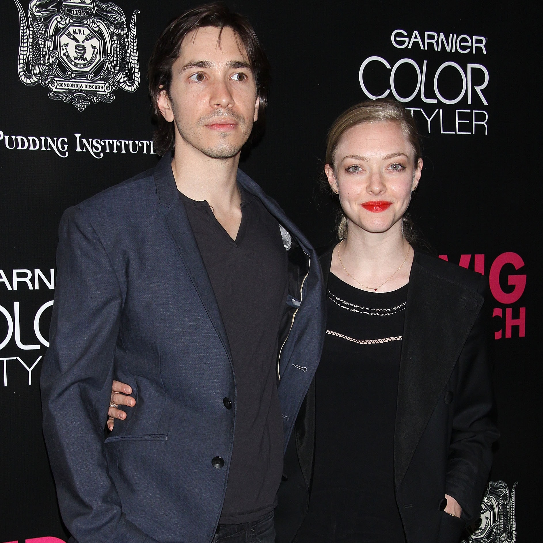 Amanda Seyfried has taken legal action over leaked photos from her vacation with Justin Long