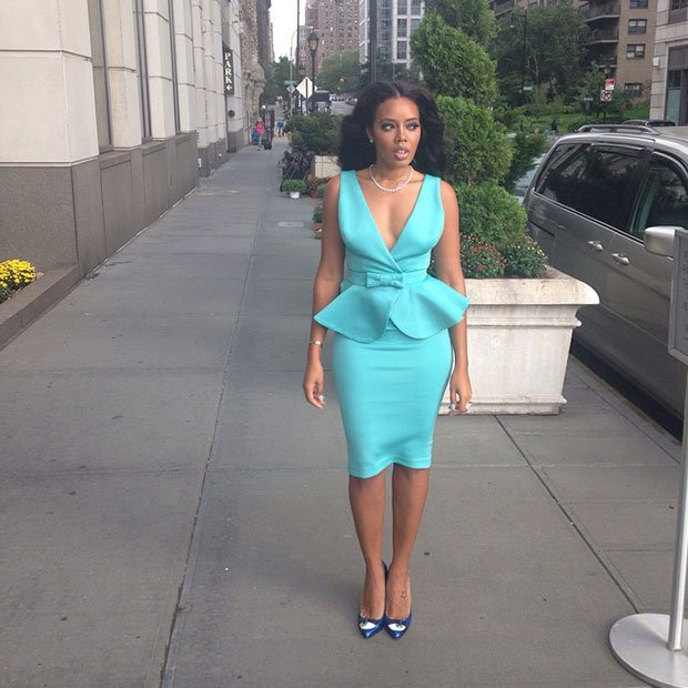 Angela Simmons'long black curls were elegantly draped over her shoulders