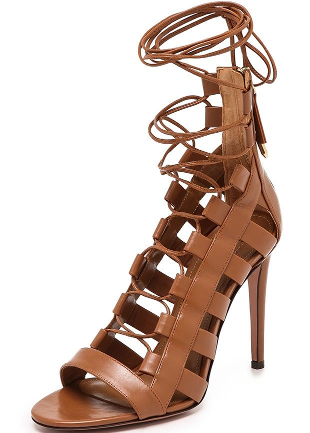 Aquazzura puts a sexy gladiator twist on these leather sandals, updating the pair with a lace-up closure and cage detailing