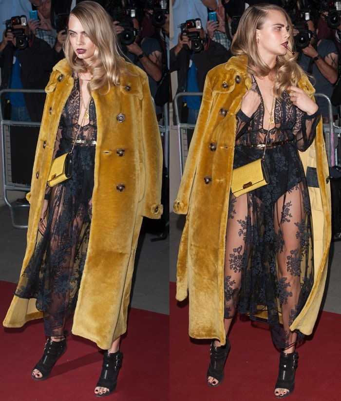 Cara Delevingne styled the black floral embroidered dress with a gold fur coat, a matching yellow leather clutch, a gold pendant chain necklace, and a pair of black peep-toe booties