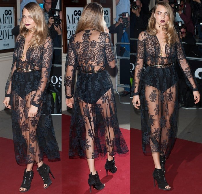 Cara Delevingne in a lacy plunge gown from the Burberry Prorsum Fall 2014 collection