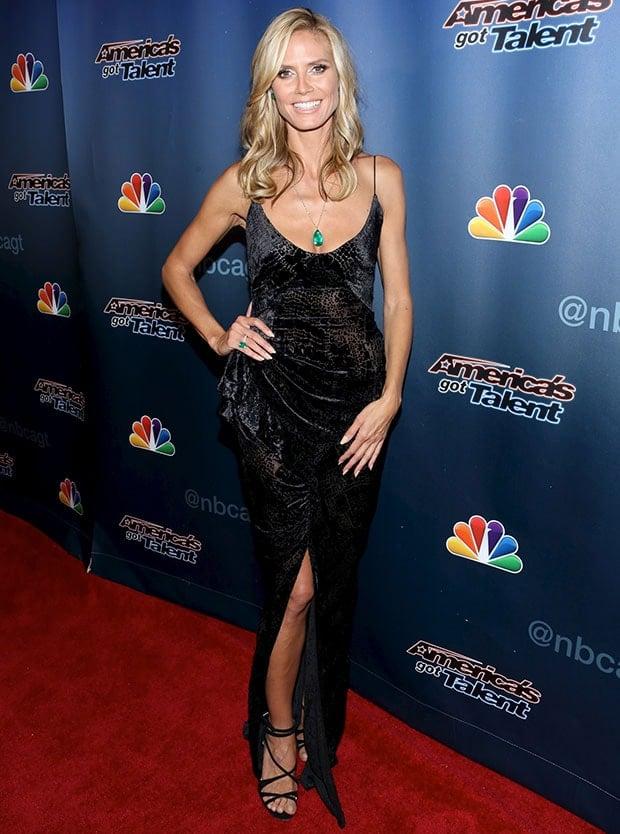 Heidi Klum went for an ultra feminine look in a slinky floor-sweeping Zac Posen dress