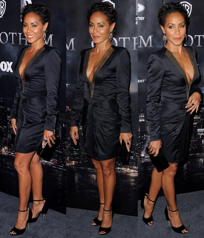 Jada Pinkett-Smithin a black dress from the Blumarine Fall 2014 collection featuring a tulip-shaped skirt and gold lapel detailing