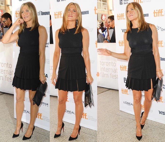 Jennifer Aniston in a black wool pleated skirt from Emanuel Ungaro paired with a Valentino top