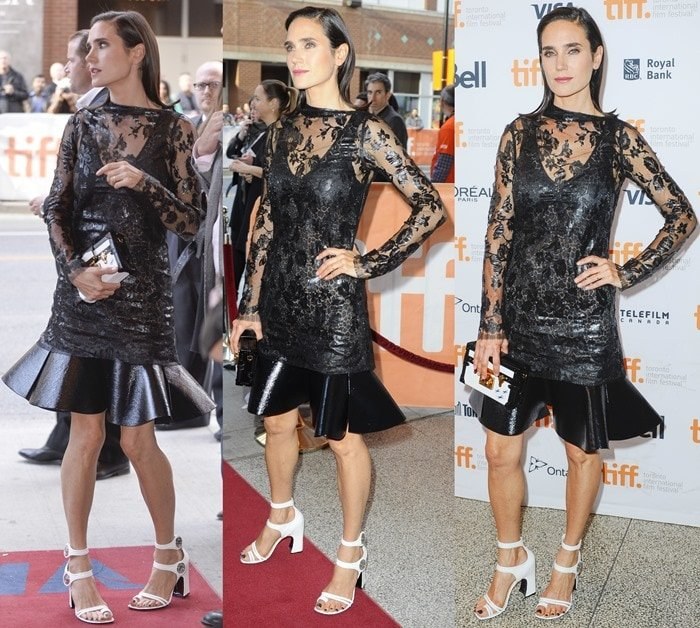 Jennifer Connelly in a black dress from the Louis Vuitton Resort 2015 Collection featuring intricate laser-cut lace overlay