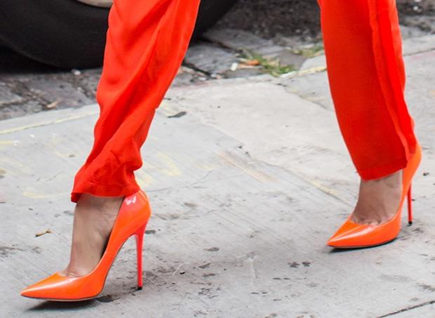 Jennifer Lopez wearing bright orange pump