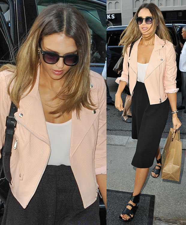 Jessica Alba in a white top, a black skirt, and a peach jacket