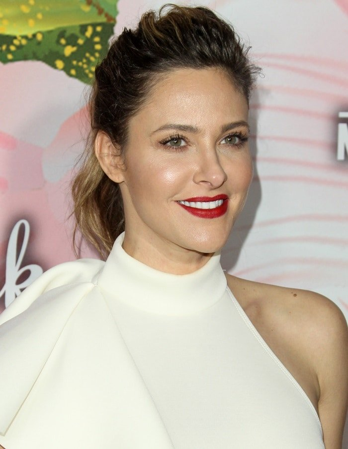 Jill Wagner with sexy red lips in a white dress