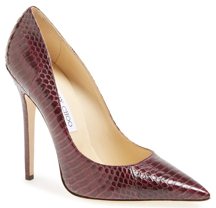 An impeccably handcrafted pump is rendered in rich, genuine snakeskin and lifted with a leg-lengthening heel for an impossibly sophisticated look