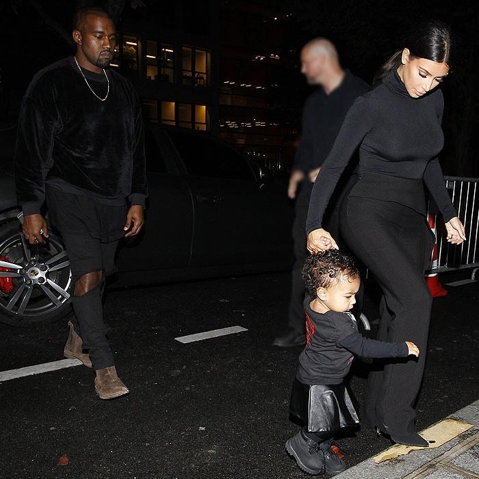 Kanye West and Kim Kardashian with North West heading tothe Balenciaga runway show