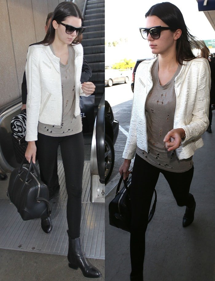 """Kendal Jenner also sported oversized sunglasses, black leggings, a leather Givenchy bag, and black """"Anouck"""" Chelsea boots by Alexander Wang"""