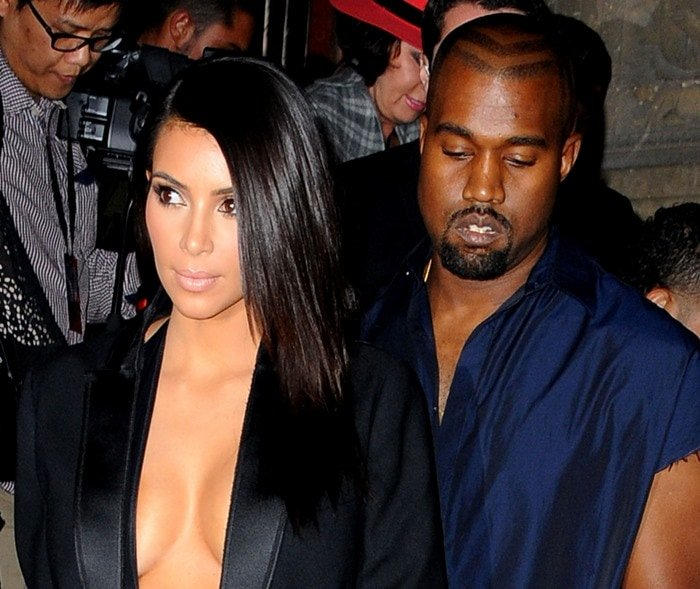 Kim Kardashian and Kanye West leaving the presentation of Lanvin's Spring/Summer 2015 ready-to-wear fashion collection, presented in Paris, France, on September 25, 2014