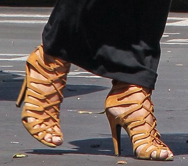 Kim Kardashian wearingher favorite Hermes lace-up heels
