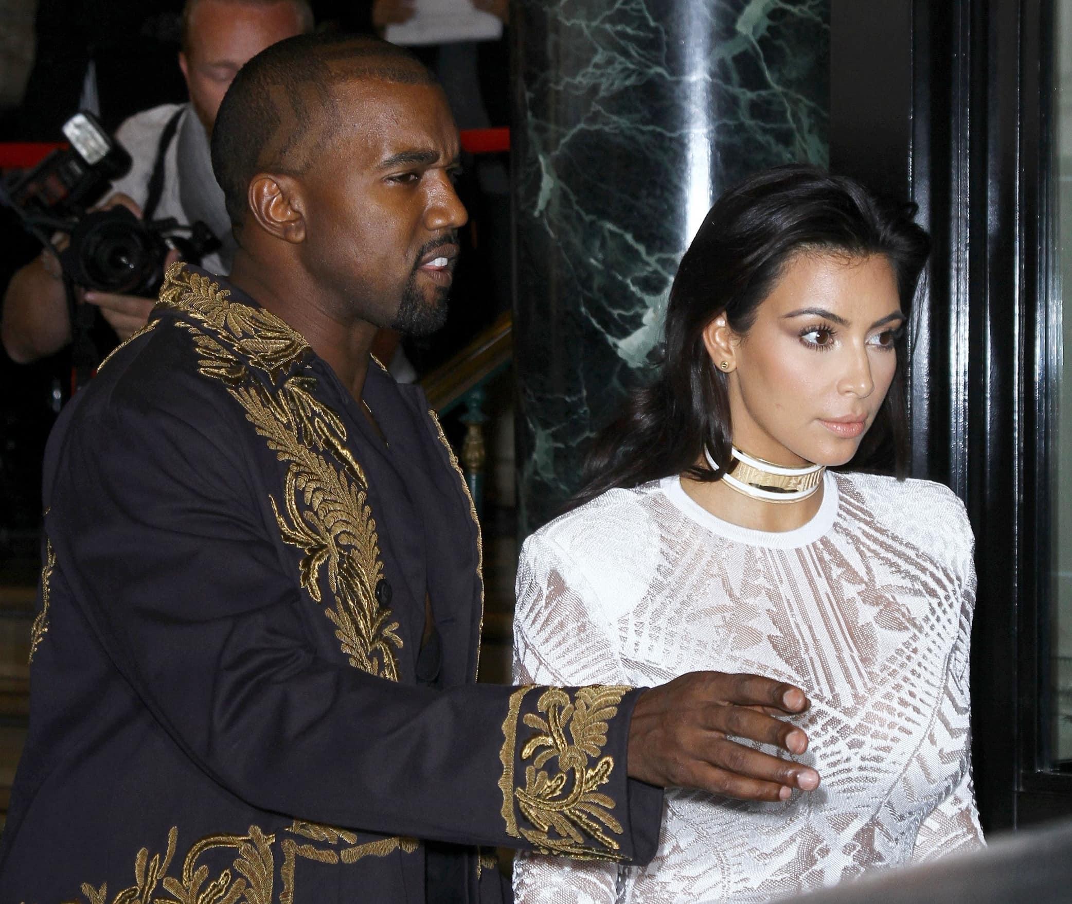 Kim Kardashian styled her white dress with a white-and-gold metallic Balmain choker