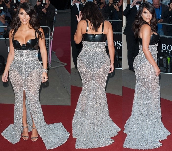 Kim Kardashian completedher outfit with embellished Tom Ford sandals and a variety of diamond bangles