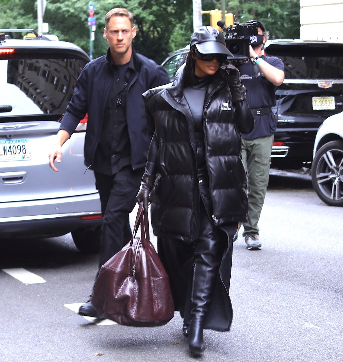 Kim Kardashian filming her new Hulu show with her tv crew after leaving her luxury hotel in New York City