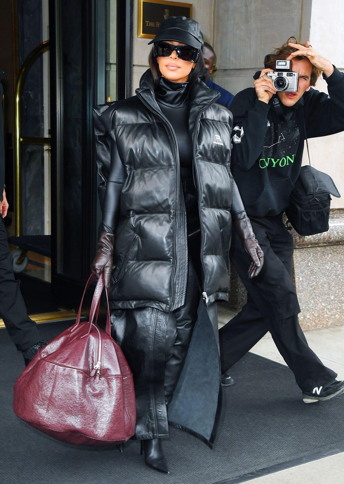 Kim Kardashian in a very Judge Dredd inspired look despite the hot muggy NYC heat