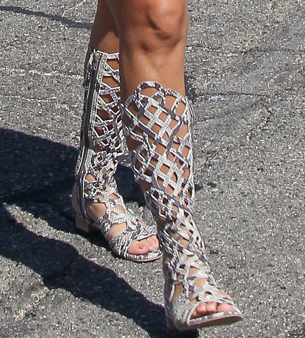 Kourtney Kardashian wearing Stuart Weitzman gladiator sandals