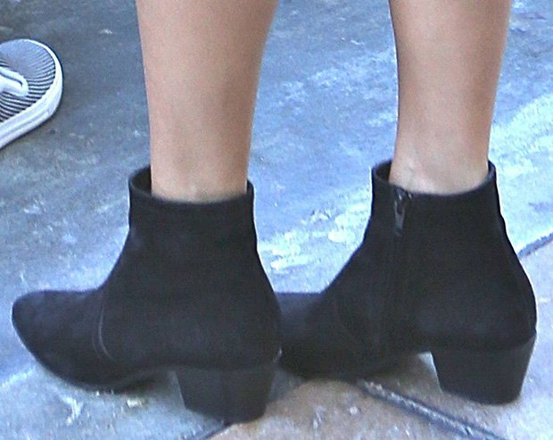 Kourtney Kardashian wearing suede ankle boots