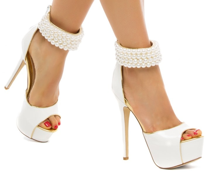 This showstopping sandal rocks patent-effect finish and a bevy of beaded accents on a sleek ankle strap