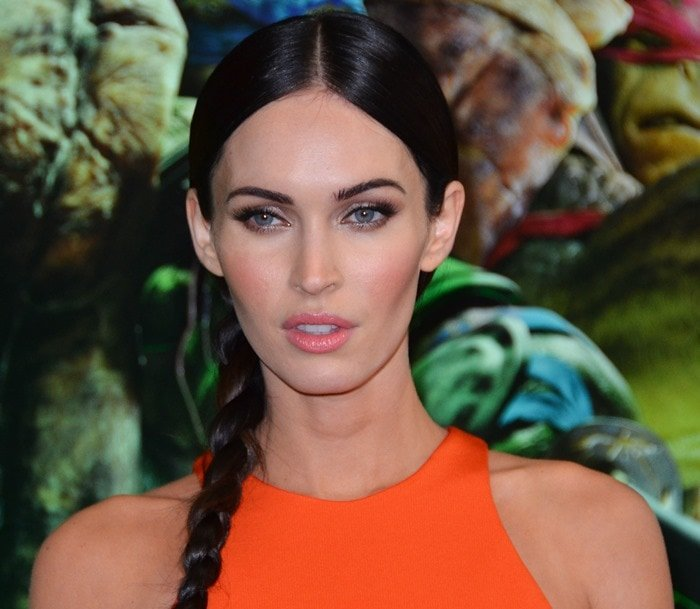 Megan Fox sported an orange cutout dress from the Cushnie et Ochs Resort 2015 collection