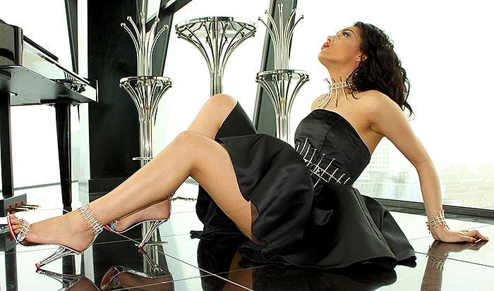 "A brunette beauty modeling the House of Borgezie's ""Princess Constellation"" stilettos"