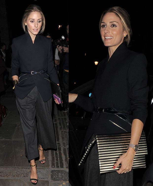 Olivia Palermo in a blazer that was cinched at the waist with a belt and a pair of wide-leg crop trousers