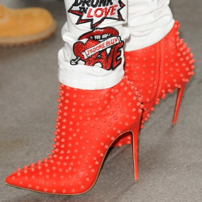 Rita Ora inred studded Christian Louboutin Snakilta booties
