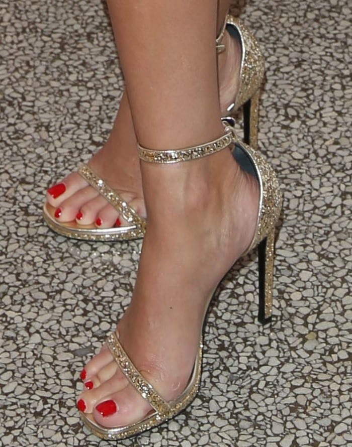 Reese Witherspoon's feet in glitter gold Saint Laurent Jane ankle-strap sandals