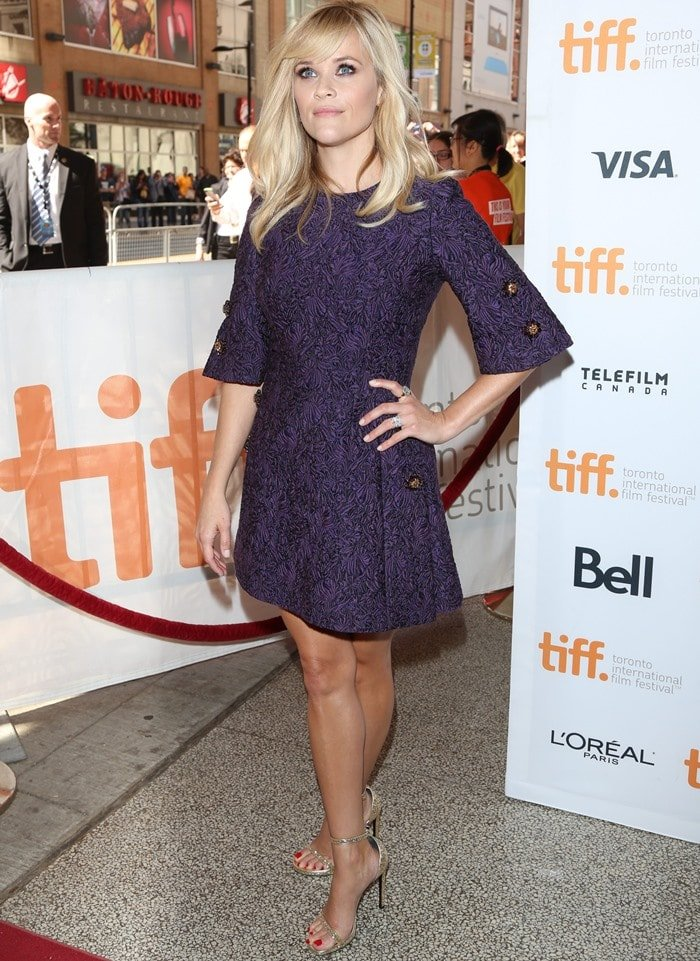 Reese Witherspoon in a purple wool-blend brocade dress by Dolce & Gabbana
