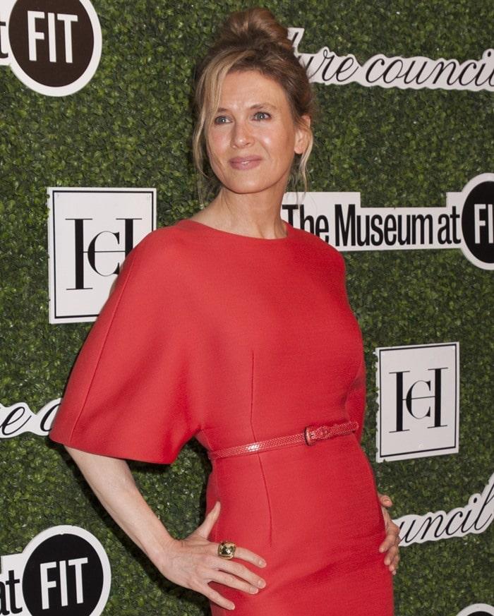 Renee Zellweger wore a tomato-red dress by Carolina Herrer