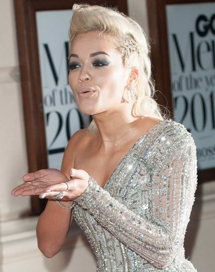 Rita Ora styled the sparkling dress with a variety of jewelry and gorgeous makeup