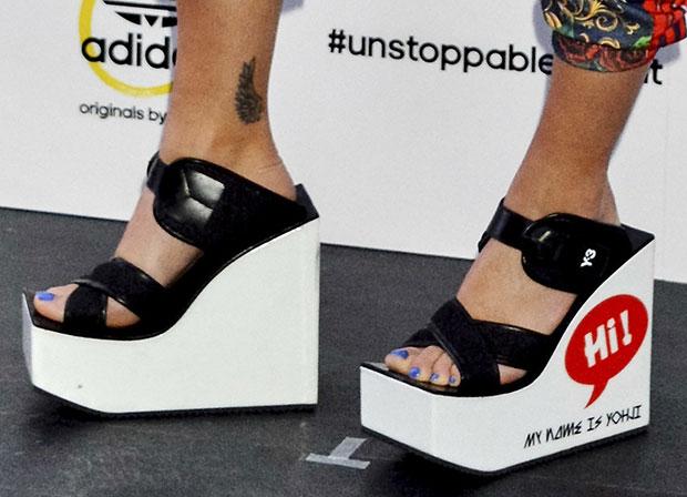 Rita Ora wearing Y-3 wedge sandals withHi! My Name Is Yohji print