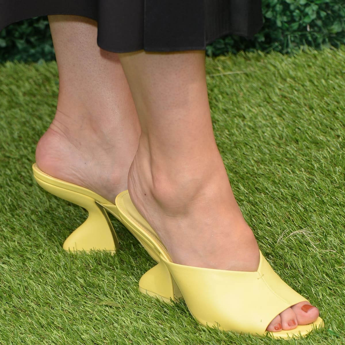 Sophia Bush shows off her feet in lambskin sandals with a notched vamp and buttercup hue