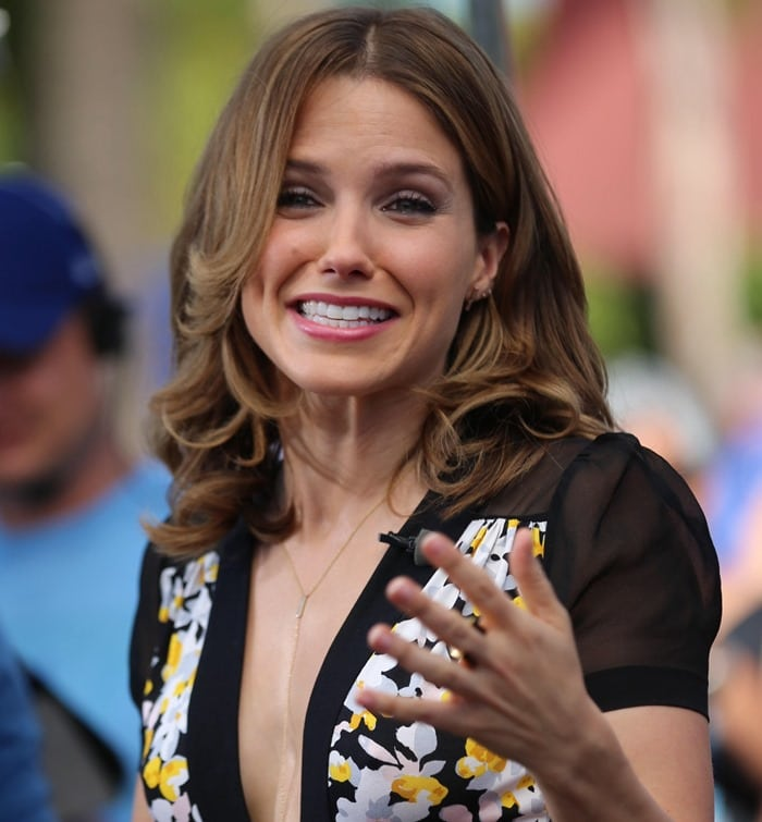 Sophia Bush accessorized with a long pendant necklace