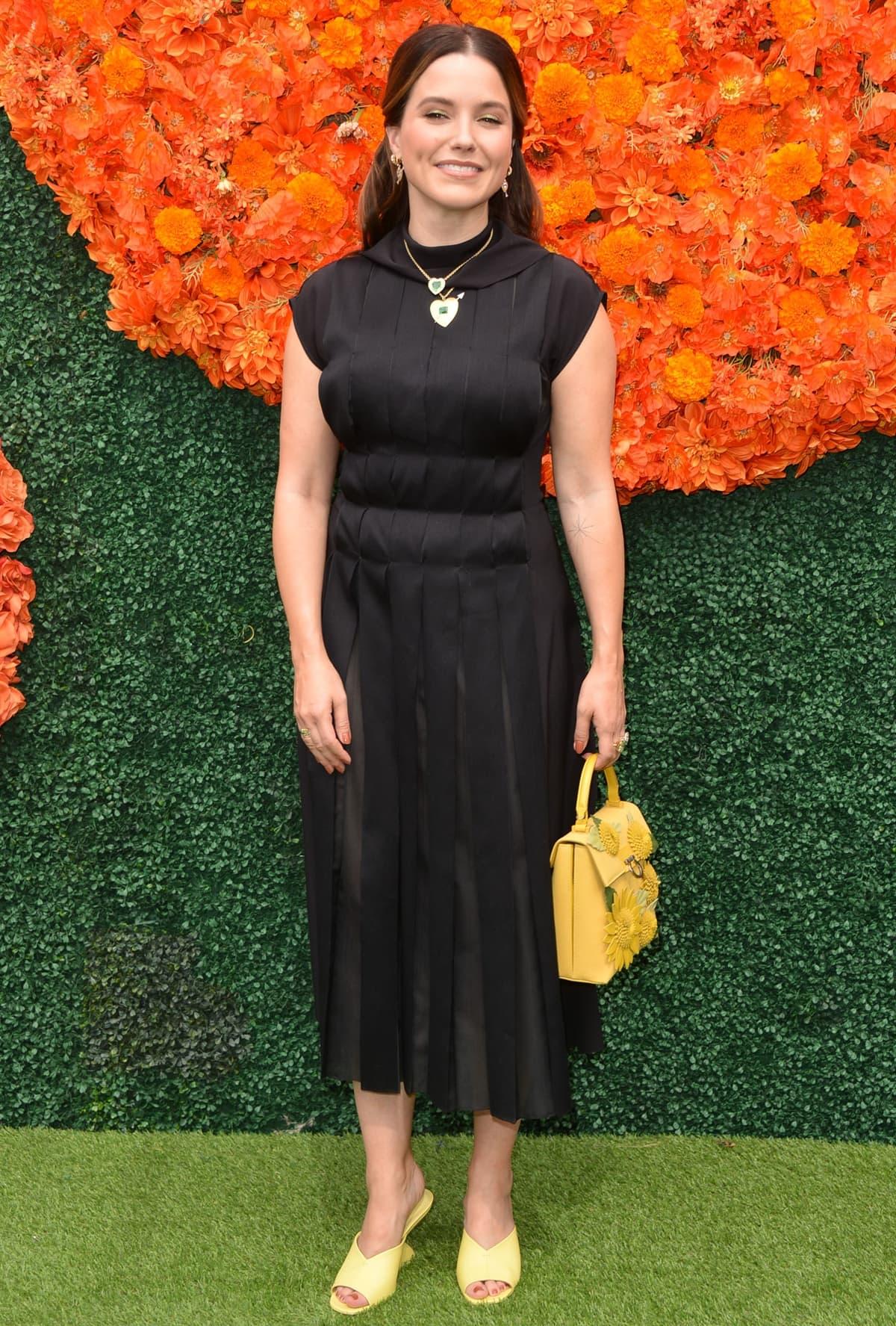 Sophia Bush wears a black Salvatore Ferragamo dress for the 2021 Veuve Clicquot Polo Classic