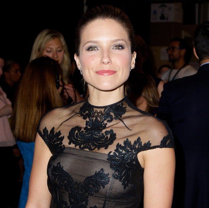 Sophia Bush ina black high-neck dress from the Monique Lhuillier Fall/Winter 2014 collection